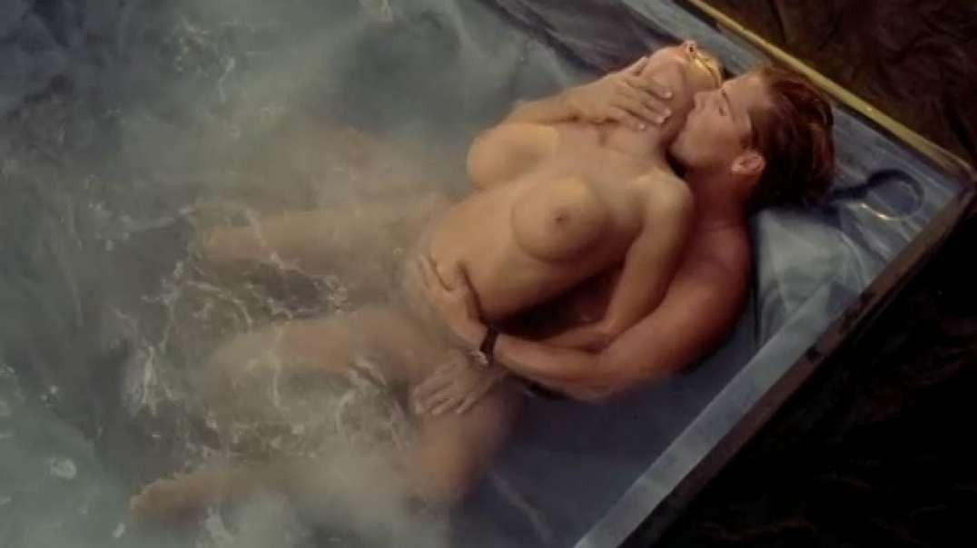 """Julie K. Smith nude in """"The Dallas Connection"""" (1994)"""